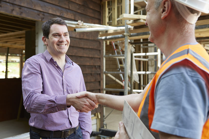 Customer Shaking Hands With Builder